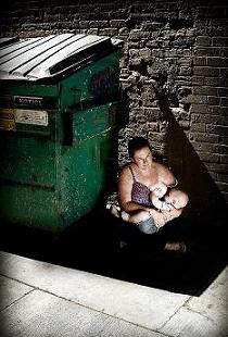 Breastfeeding by a trash can